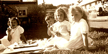 3 young girls having a picnic